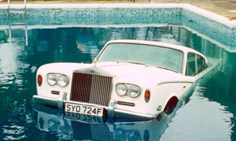 Wtf why is it that rock stars and lilo types flaunt their - Keith moon rolls royce swimming pool ...